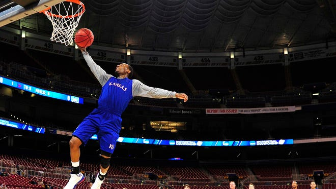 Kansas Jayhawks guard Naadir Tharpe (1) goes up for a basket during practice for the midwest regional in the 2012 NCAA mens basketball tournament at the Edward Jones Dome.