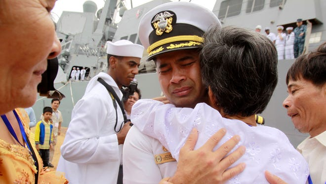 """U.S. navy officer Michael """"Vannak Khem"""" Misiewicz becomes emotional as he embraces his aunt Samrith Sokha, 72, in Sihanoukville, Cambodia."""