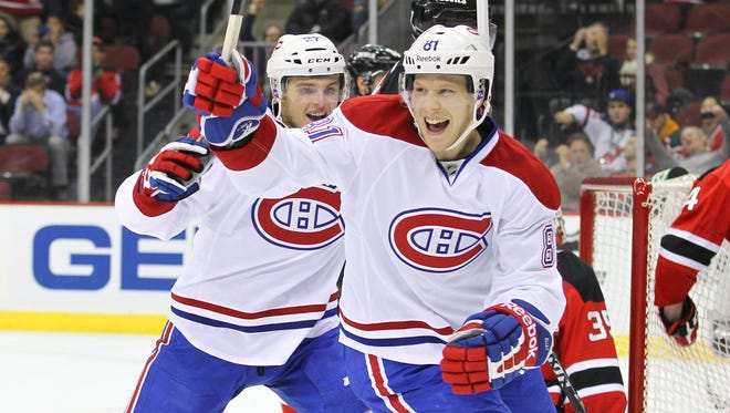 Montreal Canadiens center Lars Eller (81) celebrates his goal during the third period at the Prudential Center. The Canadiens defeated the Devils 4-3 in a shootout.