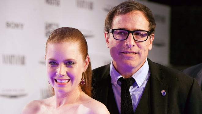 """Amy Adams and David O. Russell arrive for the Vanity Fair Campaign Hollywood """"American Hustle"""" Toast Sponsored By Chrysler - Arrivals at Ago Restaurant on February 27, 2014 in West Hollywood, California."""