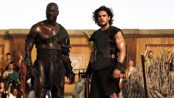 'Thrones' star Kit Harington (right) and Adewele Akinnouye-Agbaje in a scene from 'Pompeii.'