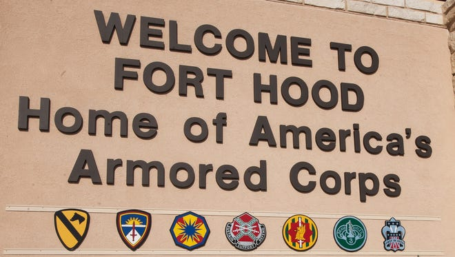 File photo dated Nov. 7, 2009, shows the main gate to Fort Hood military base in Texas.