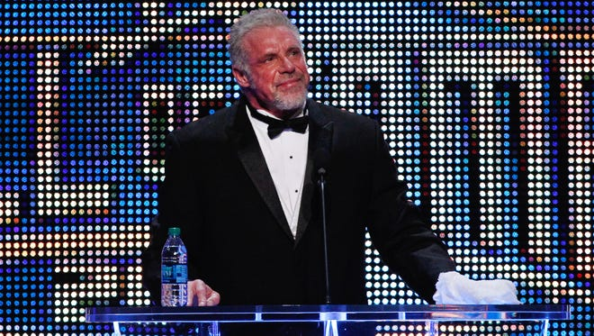 The Ultimate Warrior speaks during the WWE Hall of Fame Induction at the Smoothie King Center in New Orleans on Saturday, April 5, 2014.