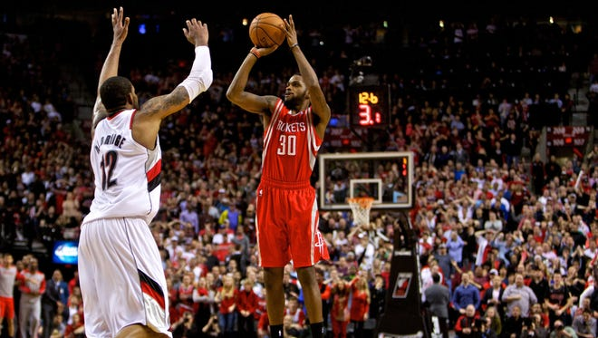 Rockets guard Troy Daniels makes a three-pointer with 12.6 seconds left in overtime to beat the Blazers in Game 3 Friday.