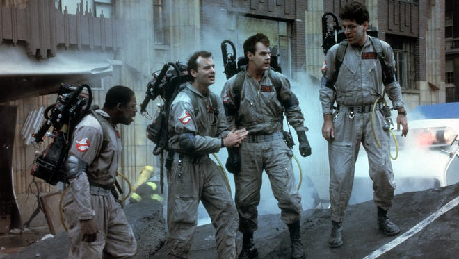 "Ernie Hudson, left, Bill Murray, Dan Aykroyd and Harold Ramis in a scene from the 1984 motion picture ""Ghostbusters."""