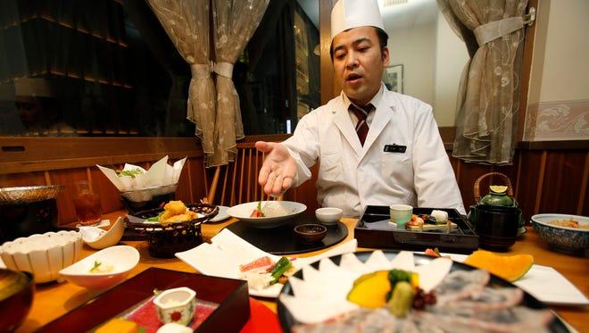 Chief chef Kenji Uda explains the menu at Japanese restaurant Irimoya Bettei in Tokyo.