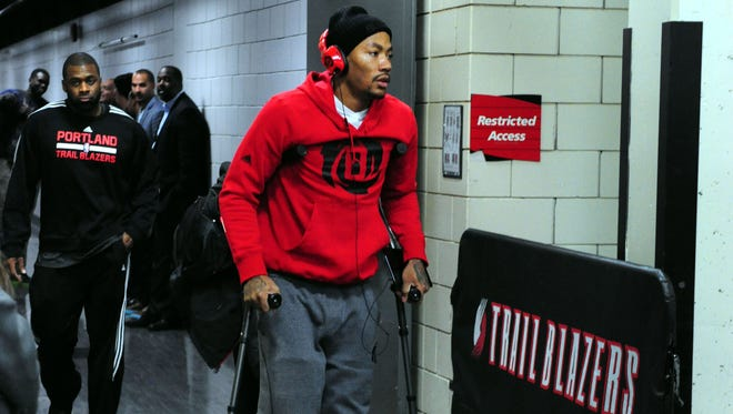 Bulls point guard Derrick Rose left Portland's Moda Center on crutches after tearing a meniscus in his right knee.