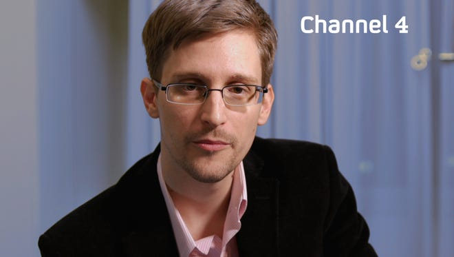 A handout picture from Britain's Channel 4 shows US intelligence leaker Edward Snowden preparing to make a December 2013 television  message, December 2013.