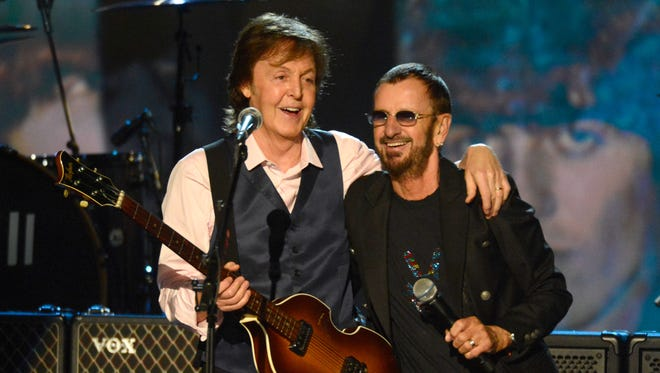 "Paul McCartney and Ringo Starr onstage at ""The Night That Changed America: A Grammy Salute To The Beatles."""