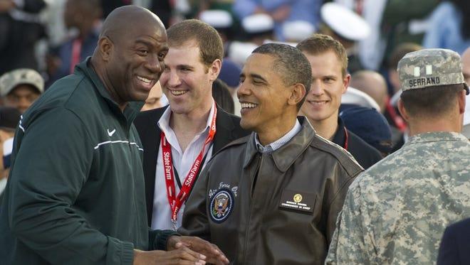 President Obama and Magic Johnson in 2011.