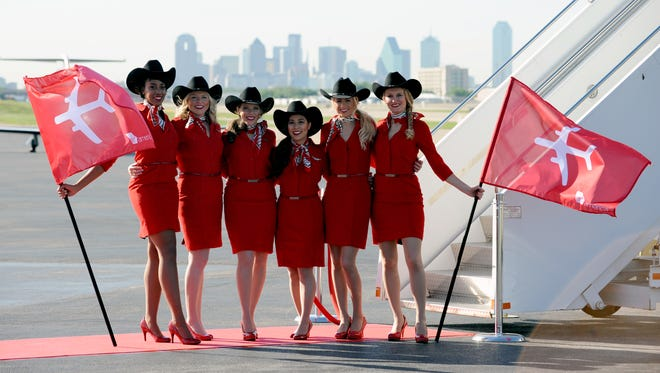 Virgin America flight attendants pose for a photo ahead of a press conference at Dallas Love Field on April 25, 2014.