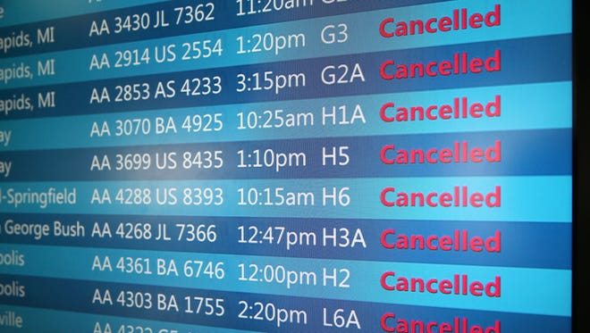 The arrival and departure display at Chicago O'Hare International Airport shows a list of cancelled flights on Sept. 27, 2014.