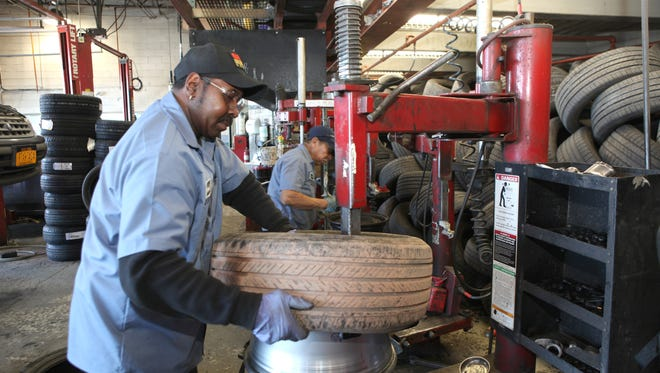 Technician Gerald Jones replaces a tire and examines a rim at Mavis Discount Tire in Nanuet, Feb. 24, 2014. There has been a significant increase in damaged tires and rims because of potholes.