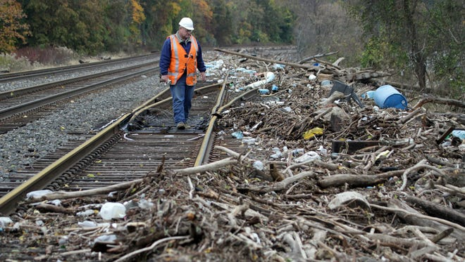 Tony Balassone, a track supervisor for Metro-North,  checks the tracks in Cortlandt Oct. 31, 2012 that are covered in debris washed up from the high winds and water surge from Superstorm Sandy.