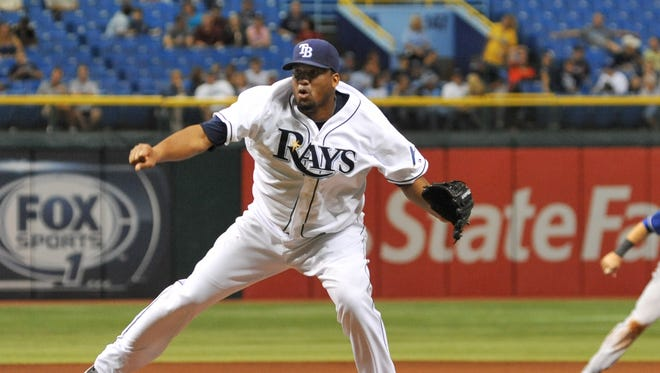 ST. PETERSBURG, FL - SEPTEMBER 17: Pitcher Roberto Hernandez #40 of the Tampa Bay Rays throws in relief against the Texas Rangers September 17, 2013 at Tropicana Field in St. Petersburg, Florida. Texas won 7 - 1. (Photo by Al Messerschmidt/Getty Images)