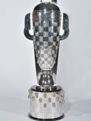 Tom Sneva, of Paradise Valley, and Arie Luyendyk, of Fountain Hills, are two Arizona connections on the 110-pound sterling silver Borg-Warner Trophy.