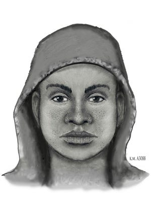 A police composite sketch of the suspect who pulled the woman out of the vehicle and stole her cellphone.