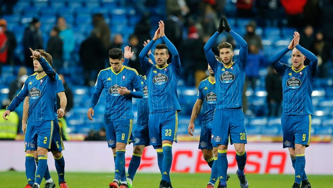 Celta players applaud their fans at the end of a Copa del Rey, quarter final, 1st leg soccer match between Real Madrid and Celta at the Santiago Bernabeu stadium in Madrid, Spain,