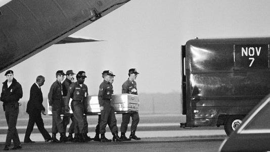 Military pallbearers at Dover Air Force Base carry one of the bodies of the Jonestown, Guyana, mass suicide on Nov. 23, 1978.