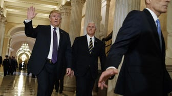 President Donald Trump and Vice President Mike Pence leave Capitol Hill after meeting with lawmakers on tax policy last week.