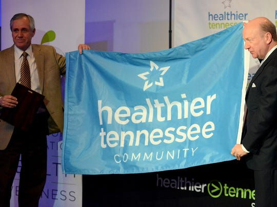 Crockett County Mayor Gary Reasons (left) is presented with a Healthier Tennessee Community flag by the president of the Governor's Foundation for Health and Wellness Richard Johnson, Wednesday afternoon.