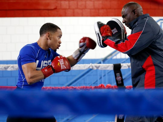 Duke Ragan, 19, trains with coach Mike Stafford at the Golden Gloves boxing gym in Over-the-Rhine  Wednesday May 3, 2017. Ragan is heading to Colorado next week to train with the U.S. Olympic team. Ragan won the 2016 National Golden Gloves, and is the 2016 USA Boxing Elite National Champion.
