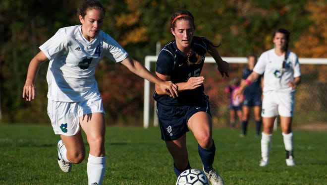 Jenna Baillargeon, left, and Colchester play at CVU while Madison Feeney and Burlington play host to MMU in Tuesday's Division I girls soccer semifinals.