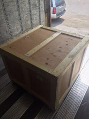 Police intercepted a crate with 450 lbs of marijuana