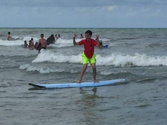 636012837589507080-SURFERS.JPG