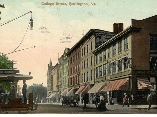 Circa 1910 postcard shows an early view of a bustling College Street. The first Merchants Bank is in the middle of the block on the right.