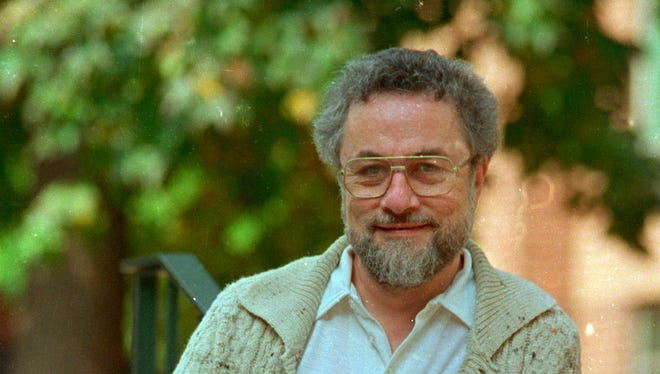 "Adrian Cronauer, left, shown in a 1987 photo, talks with Army Times about actor and comedian Robin Williams, who portrayed Cronauer in the 1987 movie ""Good Morning Vietnam."""