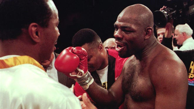 Iran Barkley, right, of South Bronx, N.Y.,congratulates his opponent, Robert Foley, not shown, after knocking him out in the 6th round of their scheduled 10 round fight in Atlantic City.