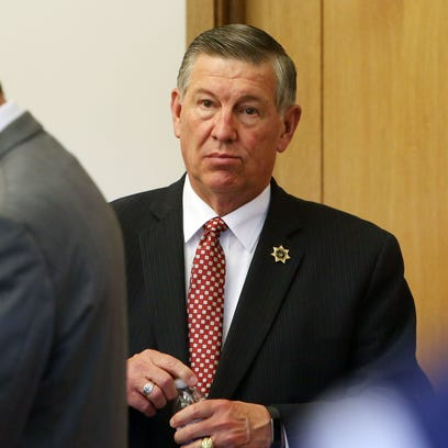 Putnam County Sheriff Don Smith leaves the courtroom