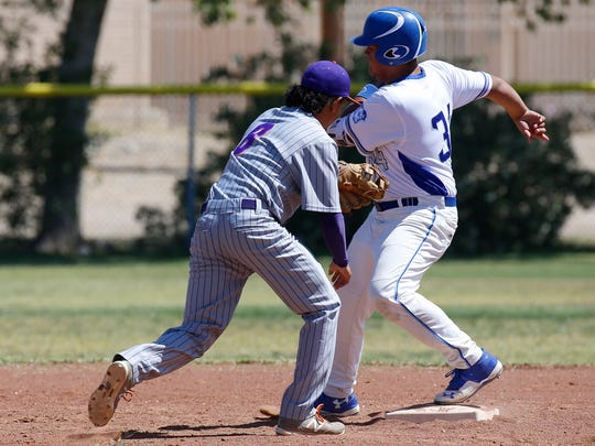 Eastlake second baseman Johnny Mendoza just misses the tag on Bowie's George Catarino during action in their Saturday morning playoff game at Bowie. The Bears would go down to Eastlake, 16-5.