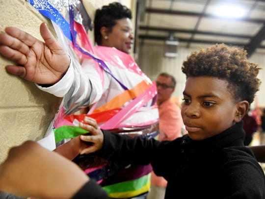 Andrew Jackson fifth grader jaeson Kidd places a strip