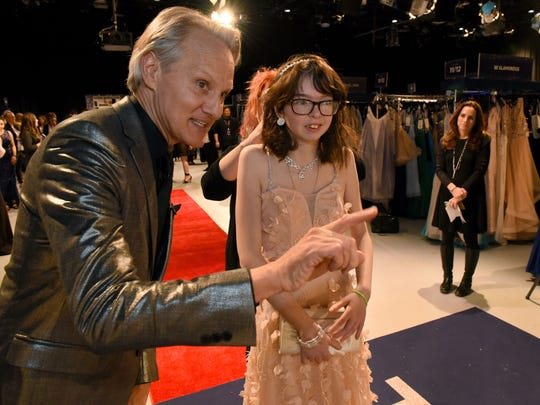 Monte Durham from TLC's Say Yes to the Prom gives direction to Priscilla Mericle as she tries on a prom dress Thursday, March 29, 2018 at the Discovery headquarters in West Knoxville. Mericle is from Fulton High School.