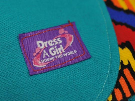 Dress a Girls Around the World dresses have this emblem