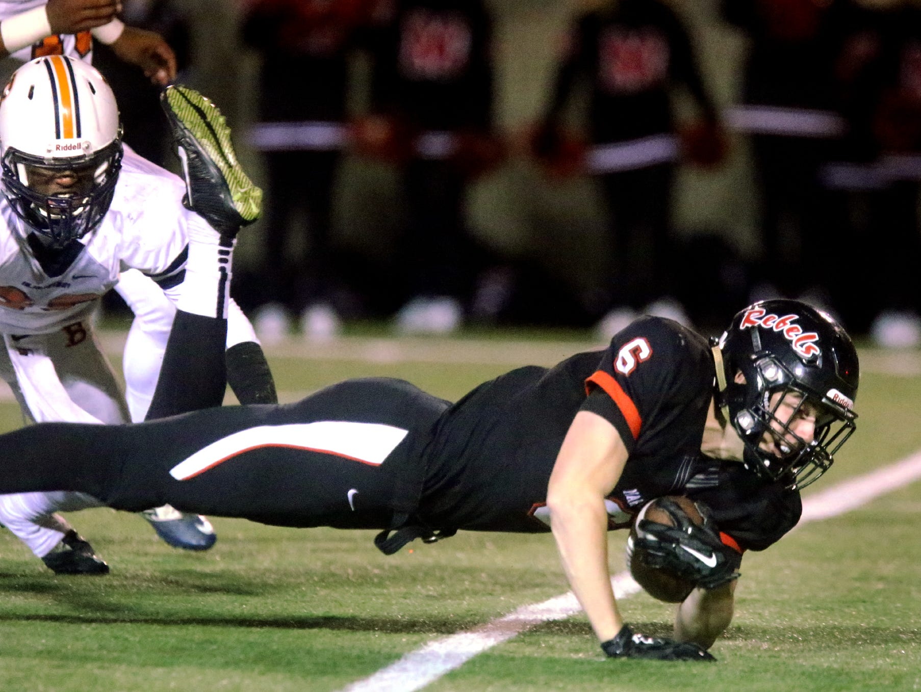 Maryville's Kelby Brock (6) dives for extra yardage during the quarterfinal game against Blackman, at Maryville, on Friday, Nov. 20, 2015.
