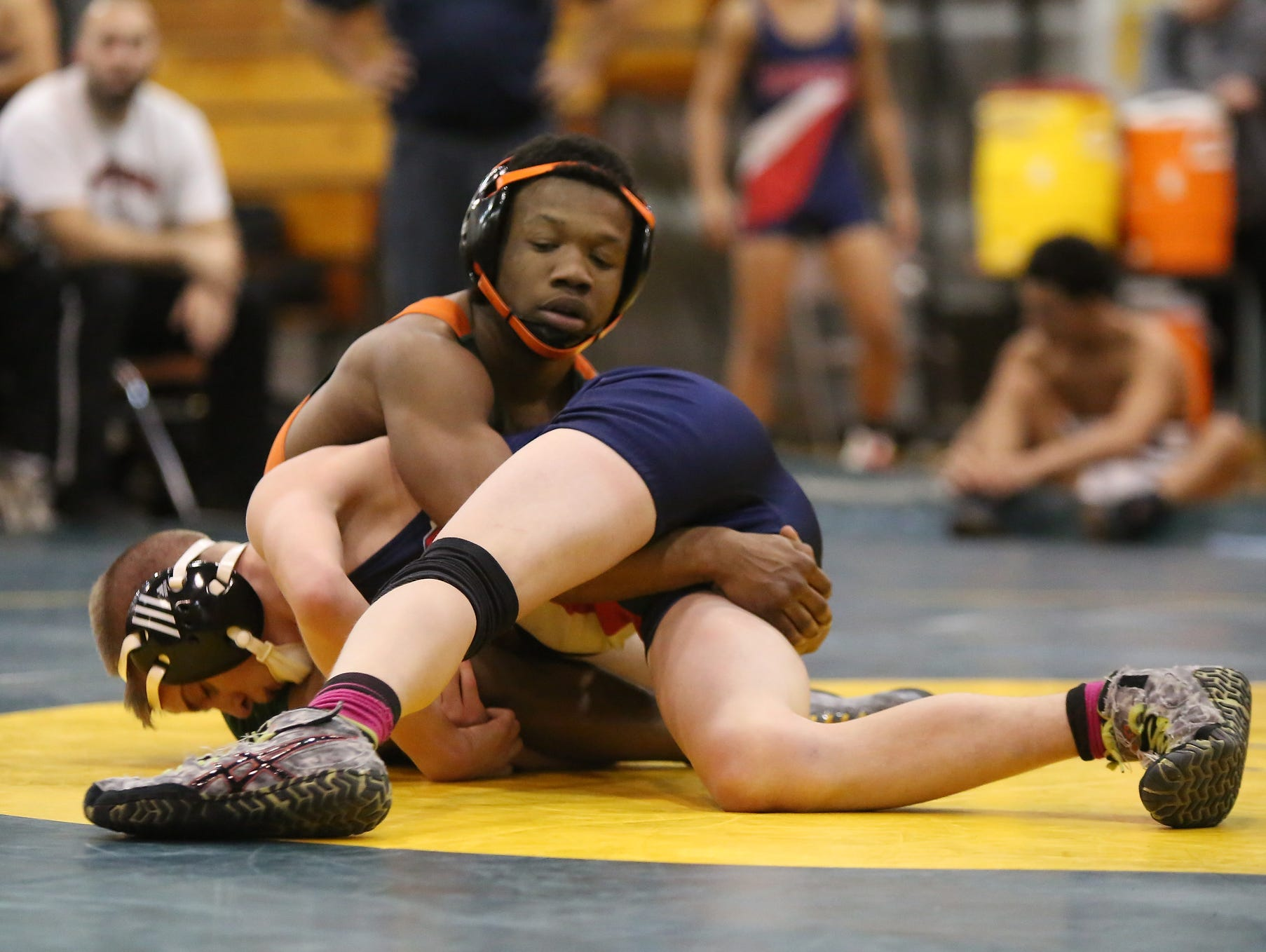 East Ramapo's Trey Wardlaw, top, wrestles Yonkers' Hunter Simoes in a 113-pound match during a quad meet in the Section 1 dual meet championships at Ramapo High School in Spring Valley on Wednesday, Dec. 2, 2015. East Ramapo defeated Yonkers 53-29 and advances to the semifinals.