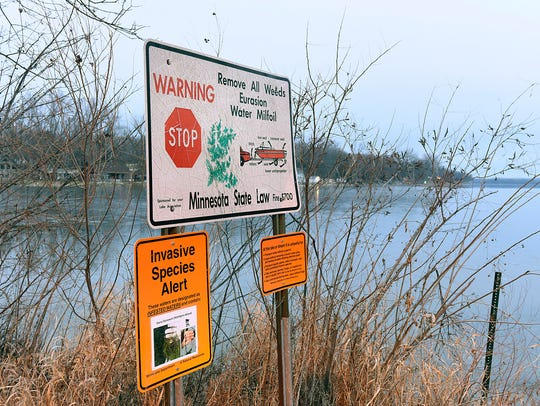 An invasive species alert is posted at the Paul Adams