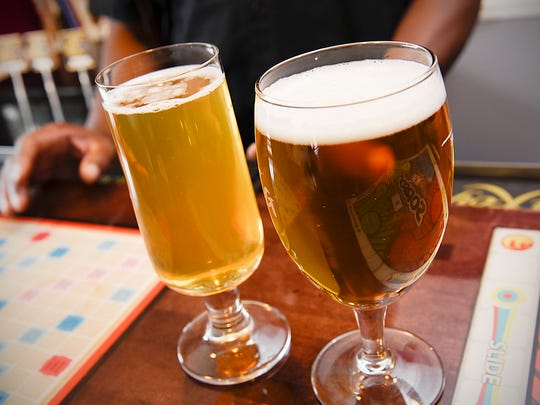 Desi and Lori Hall show some of their homebrews they have on tap Thursday, Oct. 6, at their home in St. Cloud. They will be opening The Hop Shop in Midtown Square Mall offering beer and wine making supplies.