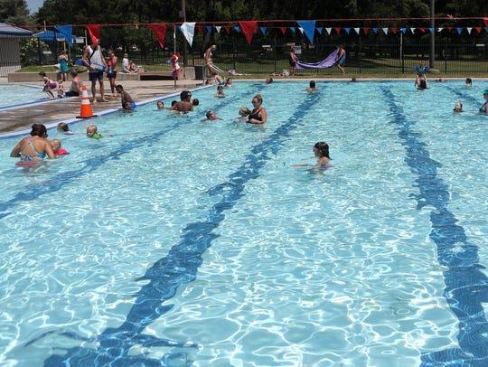People swim at the Redding Aquatic Center as temperatures