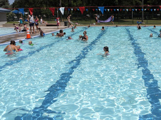 People swim at the Redding Aquatic Center as temperatures reached a high of 110 on Friday.