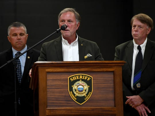Madison County Mayor Jimmy Harris, center, flanked by Madison County Sheriff John Mehr, right, and Jackson Police Chief Julian Wiser, left, at local ceremony for National Peace Officers Memorial Day on May 15 in Jackson, Tenn.