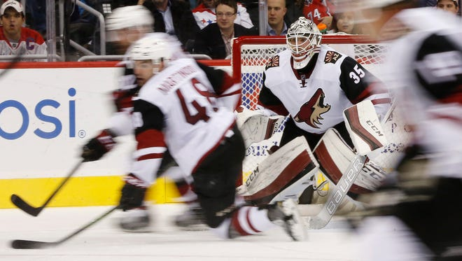Arizona Coyotes goalie Louis Domingue (35) follows the puck against the Washington Capitals in the second period at Verizon Center. The Capitals won 3-2.