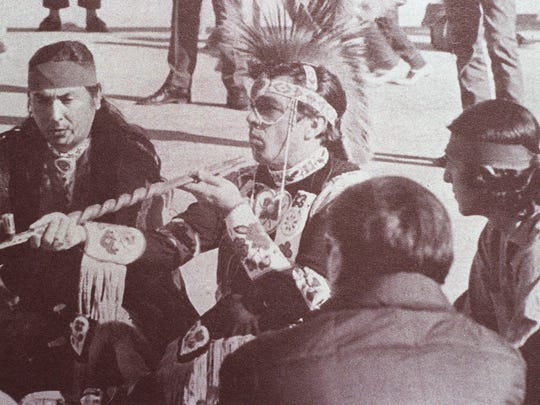 Adam Fortunate Eagle leads a pipe ceremony on Alcatraz in San Francisco Bay in 1969. MUST CREDIT photograph taken from The Sausalito-Indian Navey magazine photo by Brooks Townes