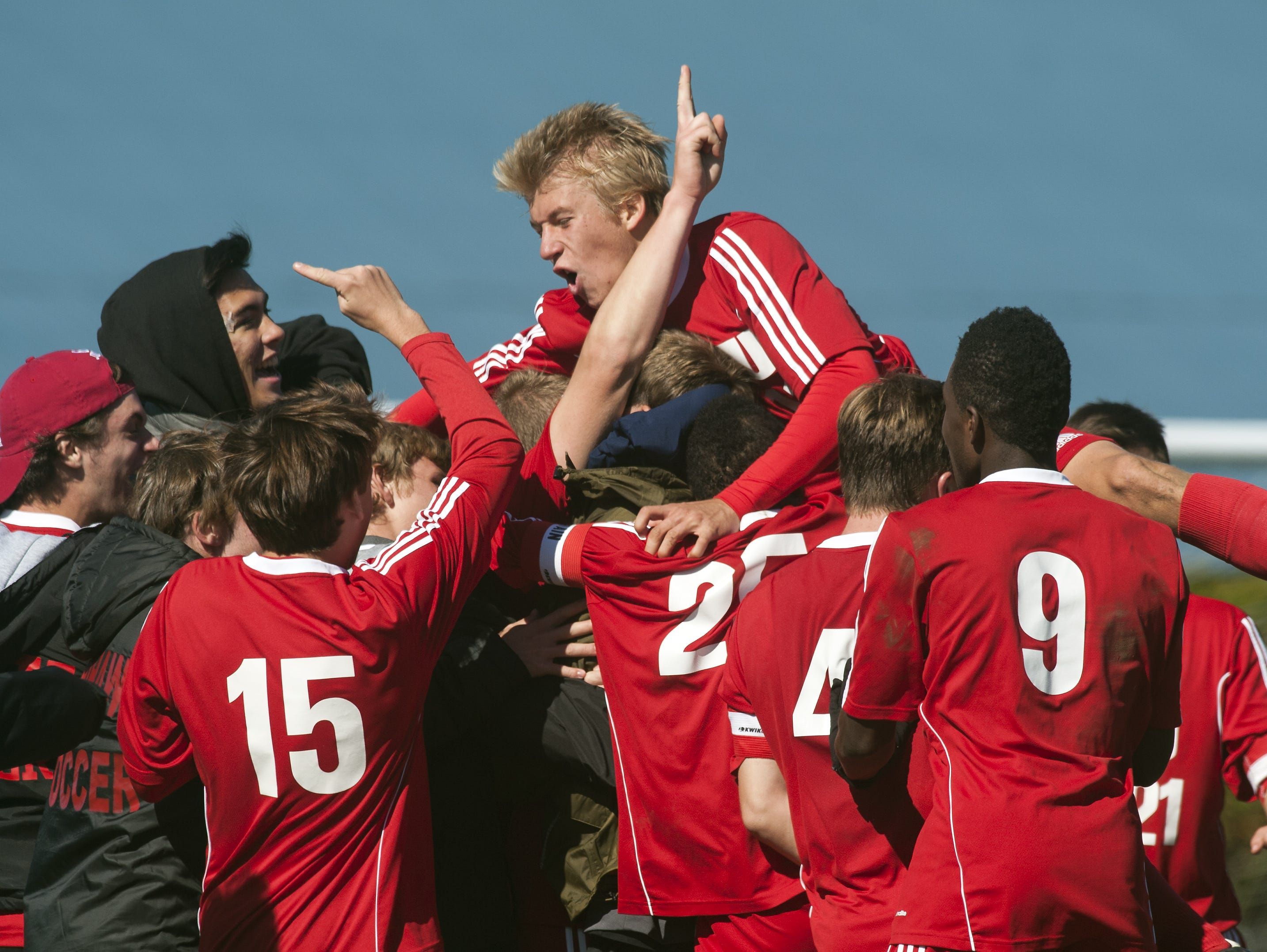 CVU celebrates an overtime goal during the boys soccer game between the Champlain Valley Union Redhawks and the Essex Hornets at Essex High School on Saturday mooring October 10, 2015 in Essex.