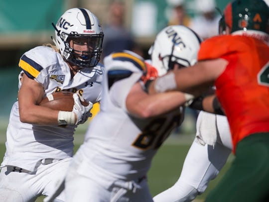 Northern Colorado running back Trae Riek tries to evade