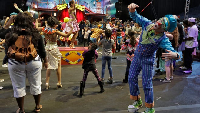 """Ringling Bros. and Barnum & Bailey clowns dance with fans during a pre show for fans Saturday, Jan. 14, 2017, in Orlando, Fla. The Ringling Bros. and Barnum & Bailey Circus will end the """"The Greatest Show on Earth"""" in May, following a 146-year run of performances."""