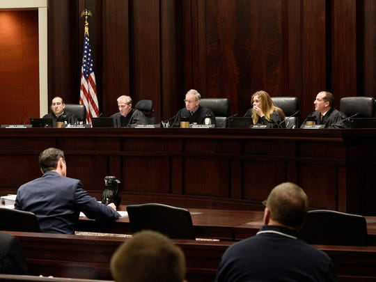 The Michigan Supreme Court says a Jackson County judge was irresponsible for communicating privately with prosecutors in disputed cases and then vilifying prosecutors when they informed defense counsel.